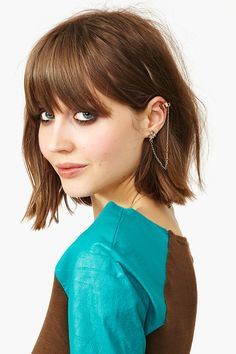 As much as I love her ear cuff I just love the short hair with bangs.