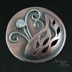 pierced and formed with a #hydraulicpress #Copper and #SterlingSilver