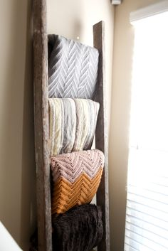 Great Idea: use an old ladder to hold blankets, for the bedroom.