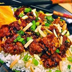 Crunchy Orange Chicken Crowned with Crispy Green Onions and Toasted Almonds