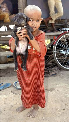 Child and puppy, Siam Reap, Cambodia.....by Glosack , flickr