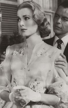 Grace Kelly, 1956 from the movie High Society.  That's frank Sinatra behind her and I love her dress in this.