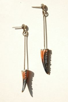 // Juliette Decubber crab claw earrings