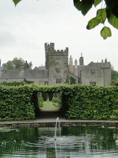 Levens Hall Gardens, Cumbria, England across a pond