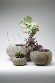 Our Rock Pots carved from smooth river rocks.