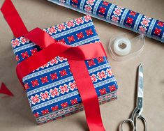 how to properly wrap a present--i worked in fancy retail stores as a college  age girl, so I learned all these tricks.  How to turn out packages that look professionally wrapped!