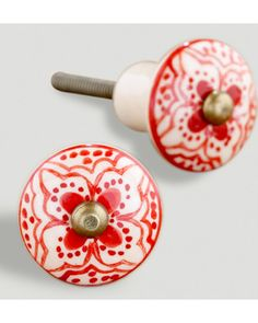 Freshen up your furniture with these knobs! Get them here: http://www.bhg.com/shop/world-market-red-basic-ceramic-floral-knobs-set-of-2-p5045e71682a7e049719e3ff8.html?mz=a