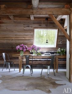 The dining room of director Shawn Levy's farmhouse in New Paltz, New York. Renovated by Bonetti/Kozerski Studio. Photo by William Waldron. Produced by Howard Christian for Architectural Digest August 2012