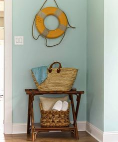Nautical life preserver ring as wall decor: http://www.completely-coastal.com/2014/10/blue-nautical-bedroom-suite.html