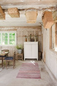 rustic barn interior + love the hanging baskets