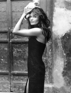 Helena Christensen with a kitten on her head. It was all the rage in the nineties