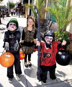 Jen Marra / Grace McShane, 6, a friendly leopard, is surrounded by zombie hockey players James and Grady Reilly, 6 and 4 respectively, all of Winslow.