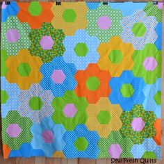 If you want to know how to make a hexagon quilt, then this free quilt tutorial will tell you how. This flower quilt pattern is both retro and sassy.