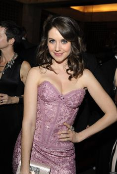 Alison Brie lovely in a strapless purple dress