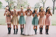 This is a great idea for a photo shoot. Also, the boots and different colors of bridesmaids dresses are done so well! #CountryWedding #WesternWedding #Bride #Bridesmaids #Photography