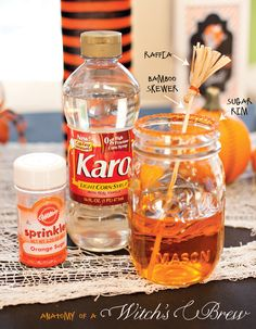 Halloween Drinks in Mason Jars with Broomstick Stirrers