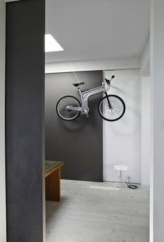 Cool bike storage, but it would be annoying getting it down every day.