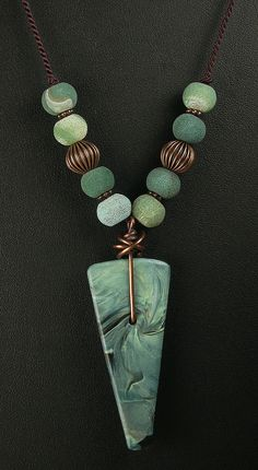 Polymer Clay Pendant Beaded Necklace featuring Green Swirl Spear Design. $32.00, via Etsy.  Lorraine Vogel