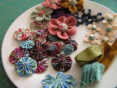 several fabric and felt flower tutorials, and an idea of how to use them