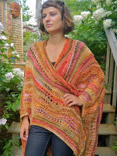 a roomy wrap (and pretty colors!) -- it's like an afghan made for wrapping yourself up into. I think some knitting mistakes would hide very easily!