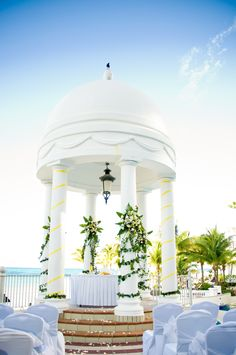 Have a wonderful wedding at Riu Palace Las Americas. This spectacular beachfront Cancun resort is located on a dazzling stretch of white sandy beach framed by tropical trees and crystal clear turquoise waters, making this the ideal place to enjoy the fun, sun, and nightlife of the magical city Cancun.  http://www.riu.com/en/weddings/   Picture taken by Adventure Weddings