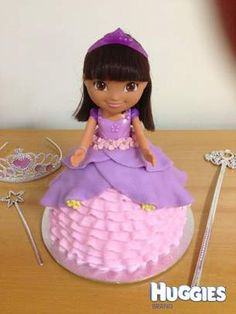 Traditional doll cake using a Dora the explorer doll instead of Barbie.  Made a chocolate mud cake using the doll cake tin.  Then used fondant to create the frills and dress adding flowers for the finishing touch :)