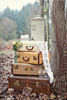 four vintage suitcases with lace