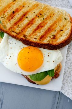 Breakfast Panini INGREDIENTS: 4 slices sourdough bread 2 tbsp. compound herb butter Gouda or white cheddar cheese, sliced (about 2 oz.)  cup baby spinach leaves 1-2 tbsp. butter 2 large eggs Salt and pepper, to taste