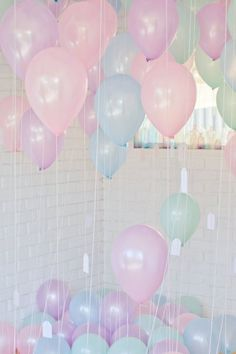 Pastel coloured balloons.