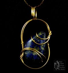 Wire Wrapped Lapis Lazuli Gold-Fill Pendant. The Cabochon was cut and polished from rough in-house in our lapidary workshop.