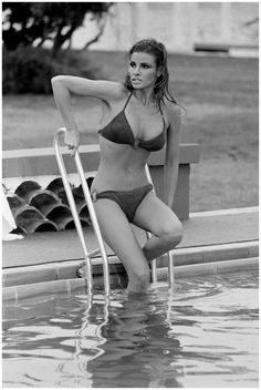 Raquel Welch enters a chilly pool during the filming of 'Lady in Cement', 1968. Photo by Terry O'Neill