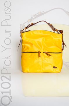 Dooney & Bourke - Medium Zipper Pocket Sac in Lemon.   Go to wkrq.com to find out how to play Q102's Pick Your Purse!