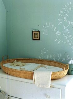 This is such a cute changing station, just a big wide basket on a dresser.