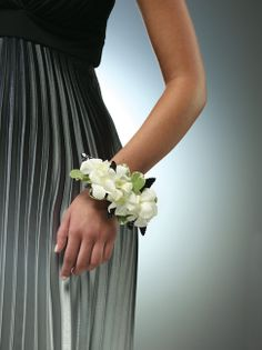 White wrist corsage with dendrobium orchids. We can do this smaller or larger.