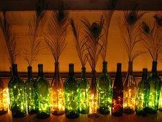 twinkle lights behind wine bottles for wedding decor