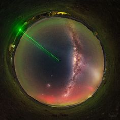 """""""Nultifarious Night Above The Lauder"""" taken in New Zealand by Petr Horálek. In this multifarious image, look for the Milky Way, the Large and Small Magellanic Clouds, a column of pale zodiacal light, green and red southern aurorae, and green lidar beams from NIWA that measure the ozone layer."""