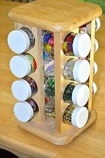 Use a spice rack for little arts and crafts materials such as glitter, beads, sequins, and googly eyes.  I like it! =)