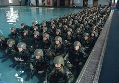 MARINE CORPS RECRUIT DEPOT, PARRIS ISLAND, SOUTH CAROLINA (1 October 2002) — Although some recruits arrive at recruit training without even knowing how to swim, they must take to the water in full battle gear with a 40-pound pack and an M-16 rifle.