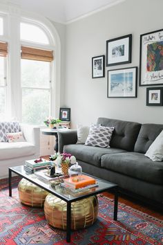 coffee tables, living rooms, rug, couch, pouf, gray walls, gallery walls, live room, coffe tabl