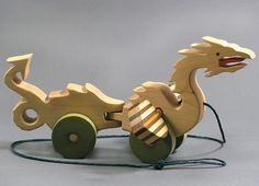Super awesome pull toy dragon! Handmade by Etsy's Arks and Animals