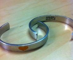 Tory Johnson's Spark & Hustle  http://suebdo.storenvy.com/products/362659-i-love-spark-hustle-orange-heart-cuff-bracelet