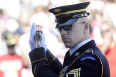 A soldier inspects a weapon during a changing of the guard at the Tomb of the Unknowns at Arlington National Cemetery, Va. #USArmy