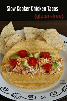 Gluten-free Slow Cooker Chicken for Tacos - This is such an easy weekday dinner! This seasoned chicken cooks 4 hours in the Crock-pot and is perfect for tacos, enchiladas, taco salad and more!
