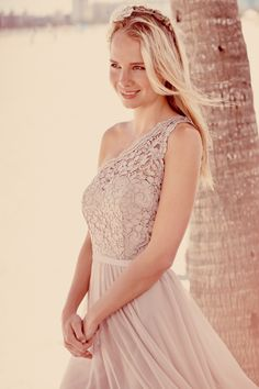 The lace details of this new bridesmaid style make it perfect for any affair. #davidsbridal #fall2014