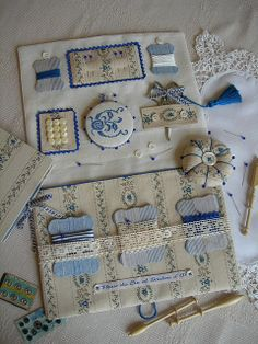 Sewing wallets and needle cases, some with embroidery and some without. No patterns, but lots of inspiration!