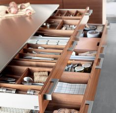 Poggenpohl's accessible storage  Kitchen island must have compartments made if good wood that doesn't chip or absorb a lot of moisture. Drawer organizers must be detachable for easy cleanup. Drawer itself must be fully extendable to allow easy cleanup and for easier reach in the corners.