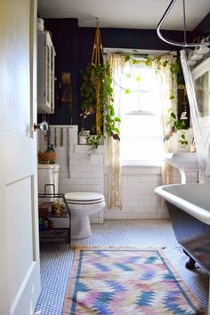 Love the walls and the plant curtains. Such a lovely bathroom
