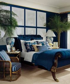 Floral prints and container plants lend a dreamy air to a traditional bedroom saturated in deep blue. | Great Harbour (RL1931), Harbor Blues Lifestyle Palette, @RalphLaurenHome Paint at The Home Depot