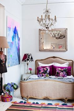 Chandelier, pretty colours, pretty bed, tassels on rug