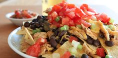 Slow Cooker Spicy Chicken Nachos - Surprise guests with this SPICY NACHOS!  YUM!  www.GetCrocked.com